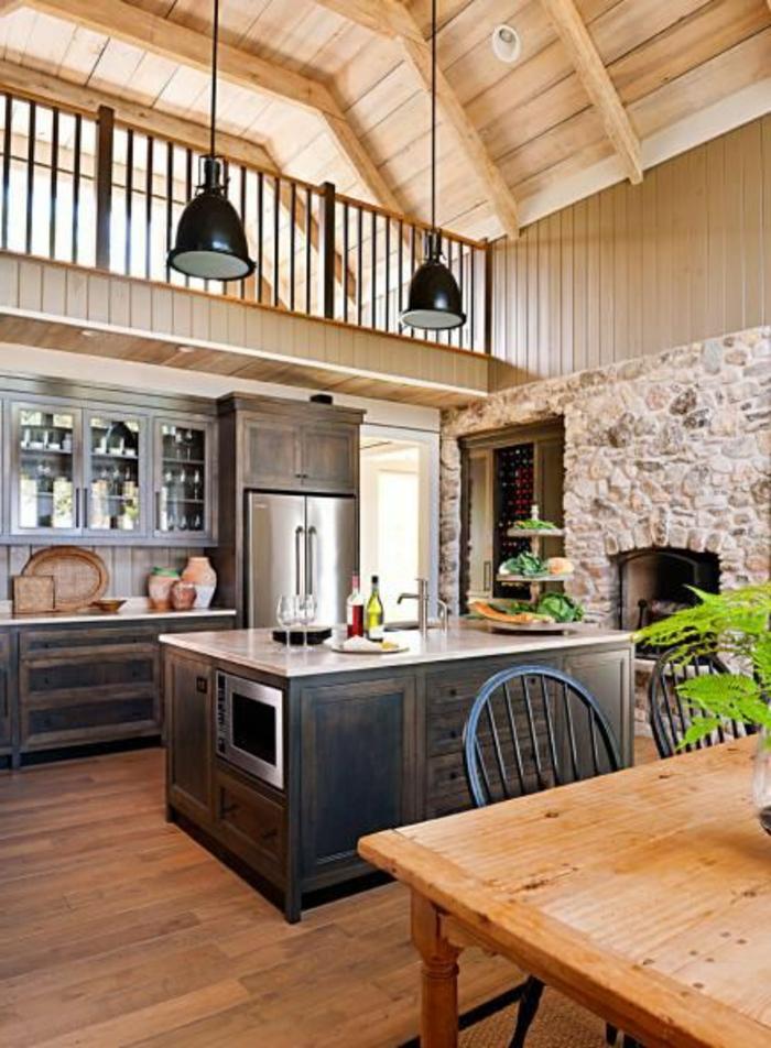 îlot-de-cuisine-central-dans-la-plus-belle-cuisine-en-bois-clair-avec-mur-de-pierres