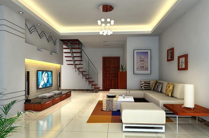 1-plafond-faux-avec-lampes-carrelage-gris-tapis-coloré-petite-tabouret-beige-plante-verte