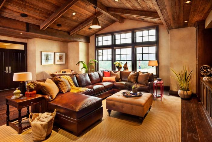 1-salon-aménagement-de-combles-meubles-en-marron-foncé-plafond-sous-pente-aménagement-de-combles