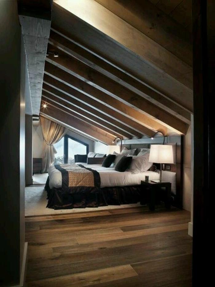 aménagement-de-combles-chambre-a-coucher-plafond-en-bois-massif-sous-pente-chambre-en-bois-foncé
