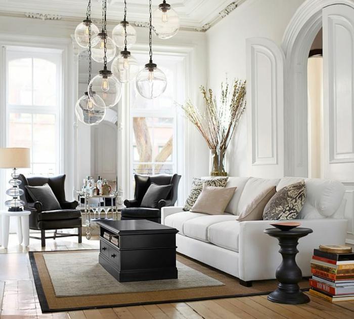 aménagement-petit-espace-avec-le-fauteuil-convertible-cuir-lit-tapis-table-basse-noir-lustre-idées