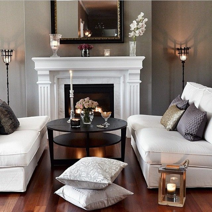 aménager-son-salon-fauteuil-transformable-aménagement-stylé-cheminé-canapés