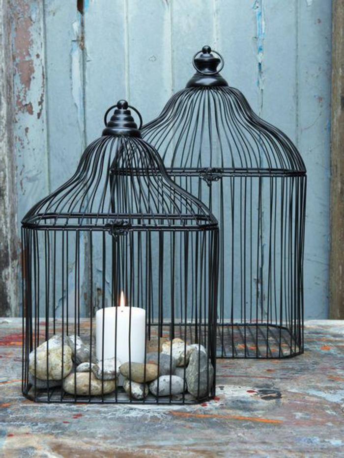 cage-à-oiseaux-décorative-décoration-avec-des-pierres-et-des-bougies