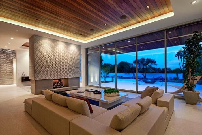 coment-faire-un-faux-plafond-salon-avec-canapé-cheminée-d-intérieur-dalles-beiges