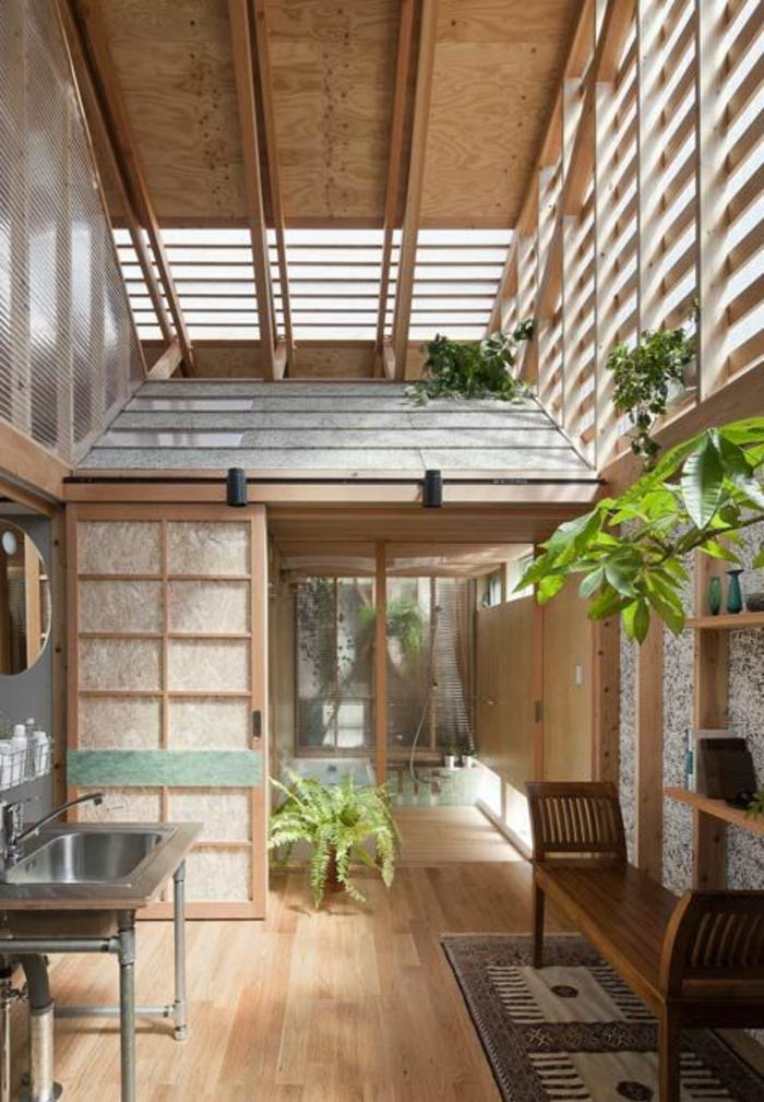 intérieur-zen-esprit-loft-sol-en-parquette-plante-verte-tapis-dans-le-salon-maison-vaste