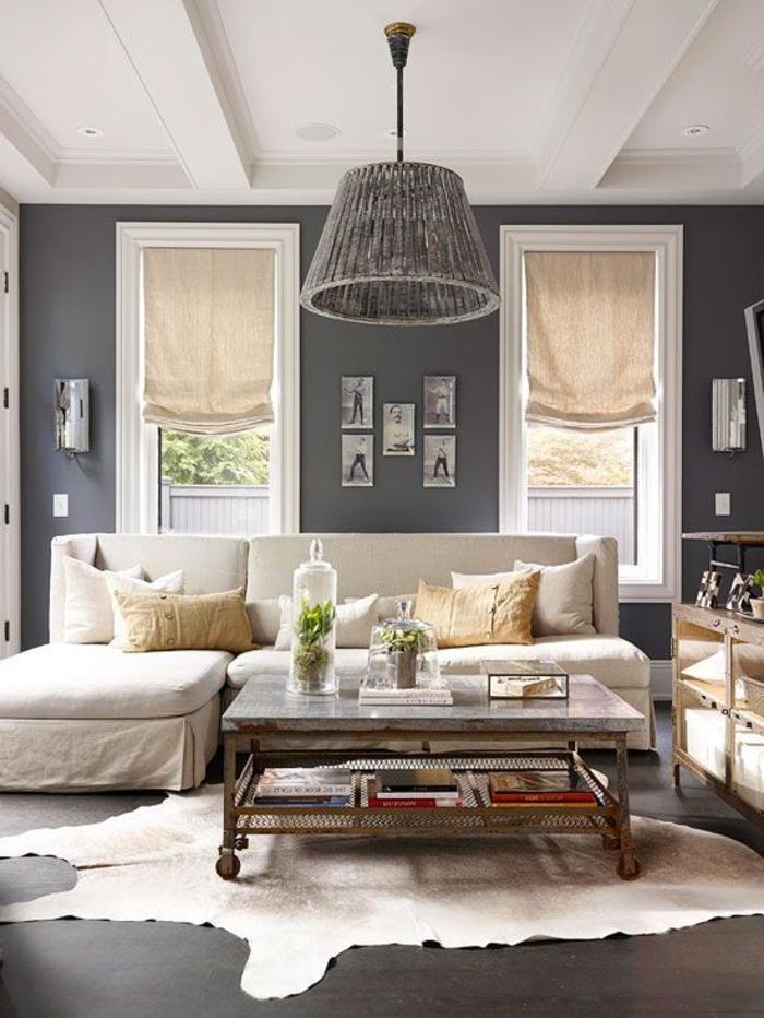 le-tapis-shaggy-en-peau-d-animal-de-vache-blanche-murs-gris-dans-le-salon-moderne