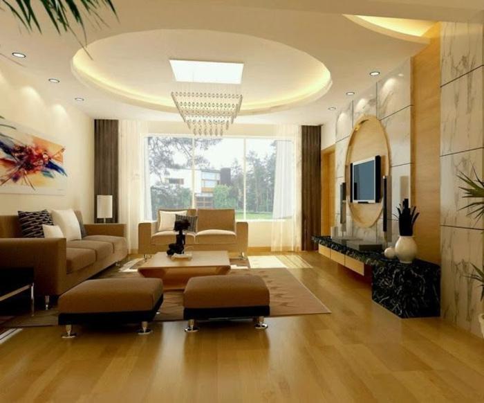 salon-avec-plafond-suspendu-beige-lustre-en-crystales-plafond-suspendu-placo-tabourets-beiges-basses