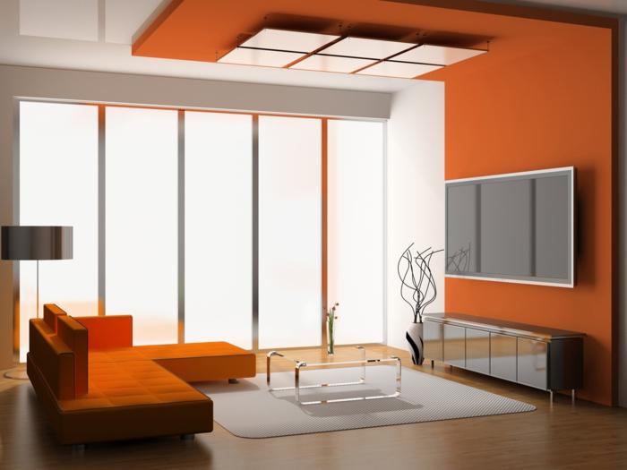 tapis-gris-petite-table-verre-transparente-canapé-orange-lampe-de-salon-gris-fenetre-grande-lampe-de-salon-gris