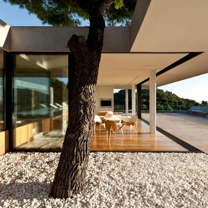 0-le-minimalisme-en-architecture-jolie-maison-avec-cailloux-décoratifs-et-maison-moderne
