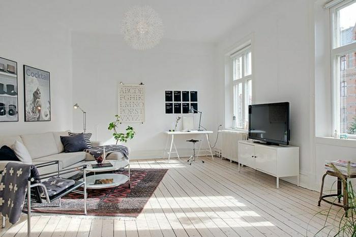 un joli salon avec deco nordique et tapis scandinave de couleur rouge