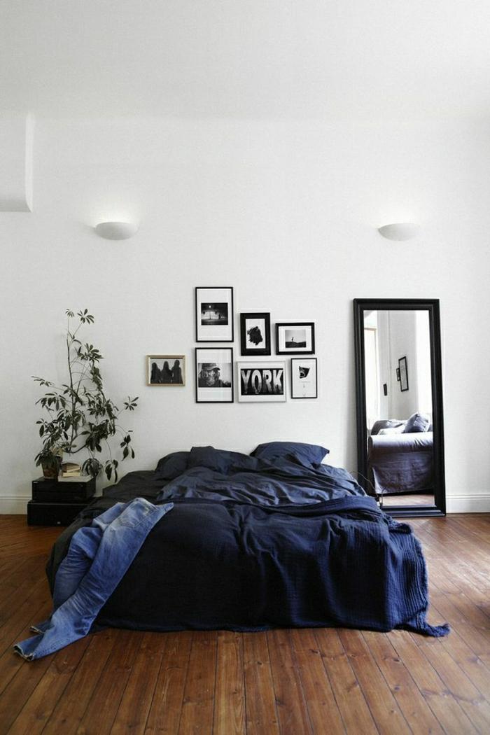 2-une-jolie-chambre-à-coucher-avec-linge-de-lit-bleu-et-parquet-contrecolé
