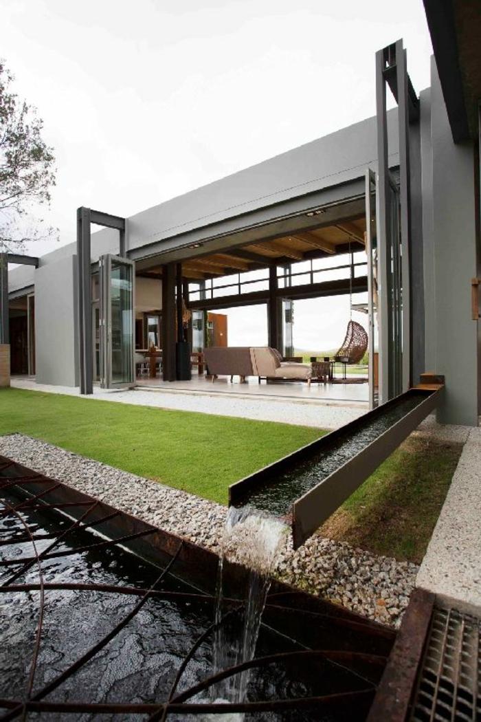 architecture-minimaliste-pour-une-maison-contemporain-avec-1-etage-et-jardin-pelouse-verte