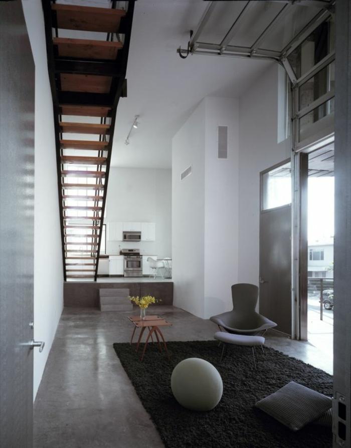 béton-ciré-plan-de-travail-un-joli-salon-avec-intérieur-gris-et-tapis-gris-foncé-murs-blancs