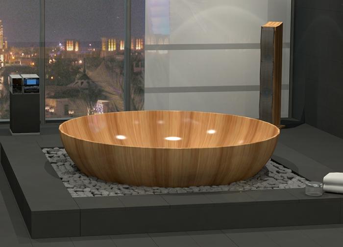 baignoire-ronde-en-bois-posée-sur-une-plateforme-avec-cailloux