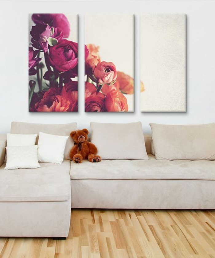 deux-volets-se-replient-sur-le-panneau-central-tableau-triptyque-fleurs-roses-canapé-d-angle