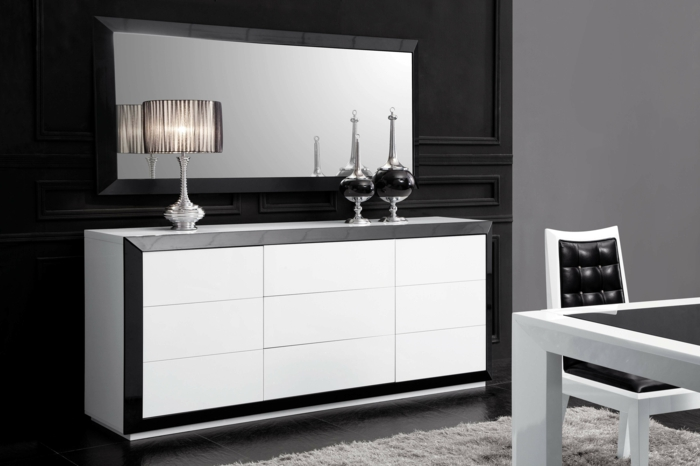 intérieur-blanc-noir-tapis-gris-dans-la-salle-de-séjour-avec-une-chaise-et-table-de-cuisine