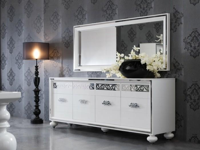 joli-bahut-blanc-laqué-avec-miroir-decoratif-dans-le-salon-avec-sol-gris