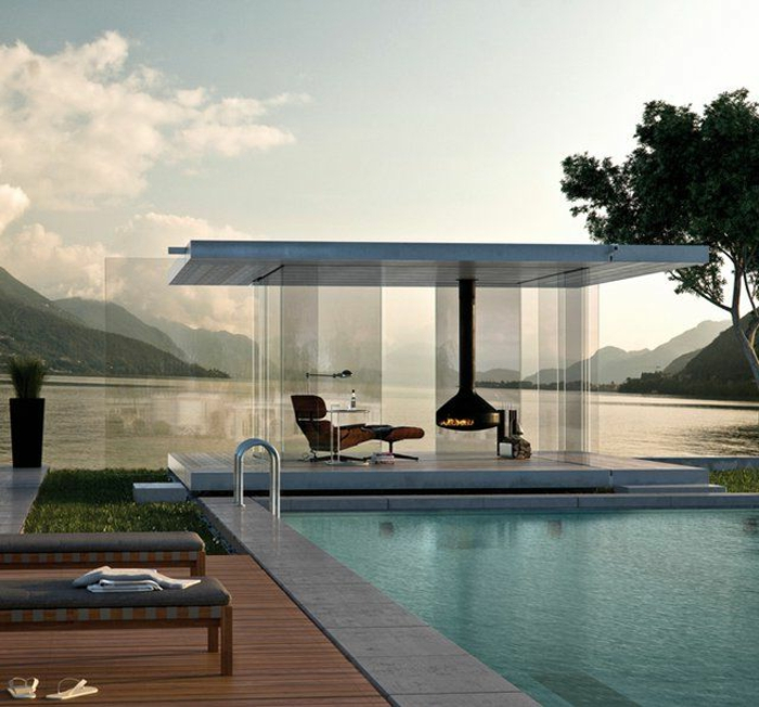 le-minimalisme-en-architecture-avec-une-piscine-moderne-murs-en-verre-et-cheminée-d-intérieur