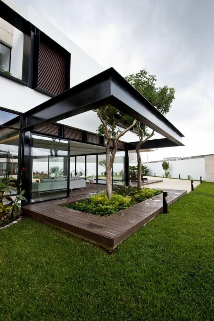 maison-contemporaine-de-style-minimalisme-avec-pelouse-verte-dans-le-jardin-grand