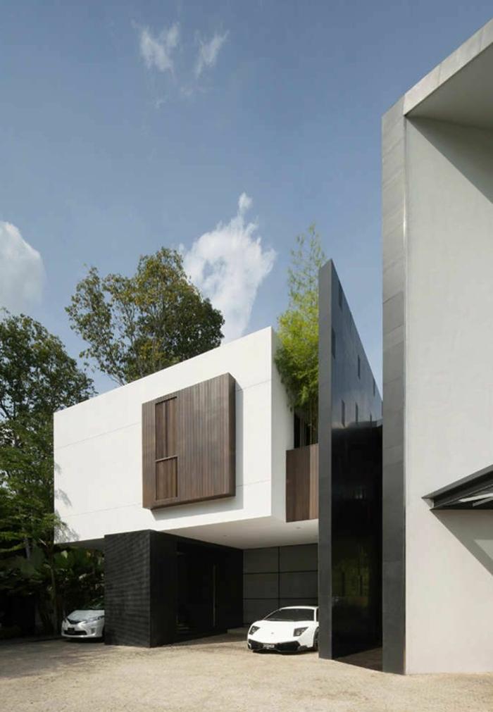 maison-contemporaine-de-style-minimalisme-avec-voitures-de-luxe-blanches