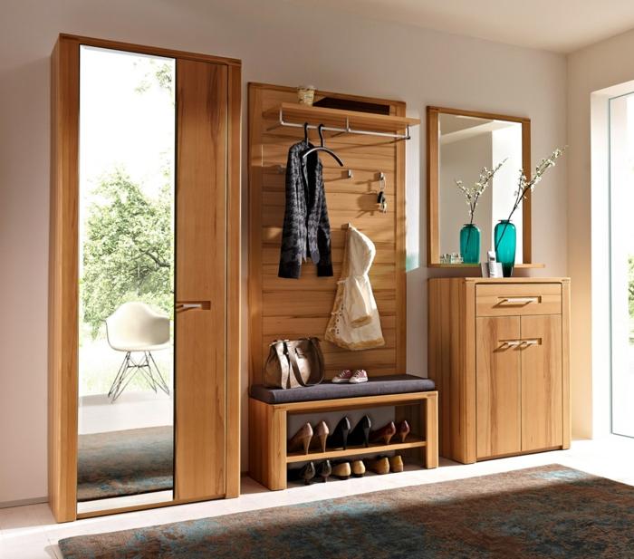 quels-meubles-gain-de-place-choisir-pour-l-entrée-avec-un-joli-tapis-beige-et-bleu