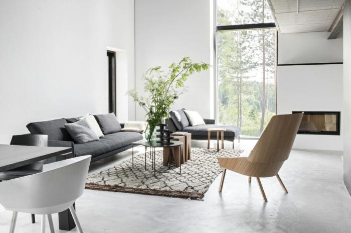 salon-design-scandinave-pas-cher-avec-fenetre-grande-et-un-salon-d-esprit-loft-tapis-beige-canape-gris