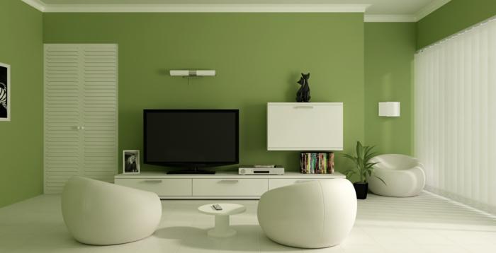 un-joli-salon-avec-peinture-murale-de-couleur-verte-clair-et-meubles-blancs