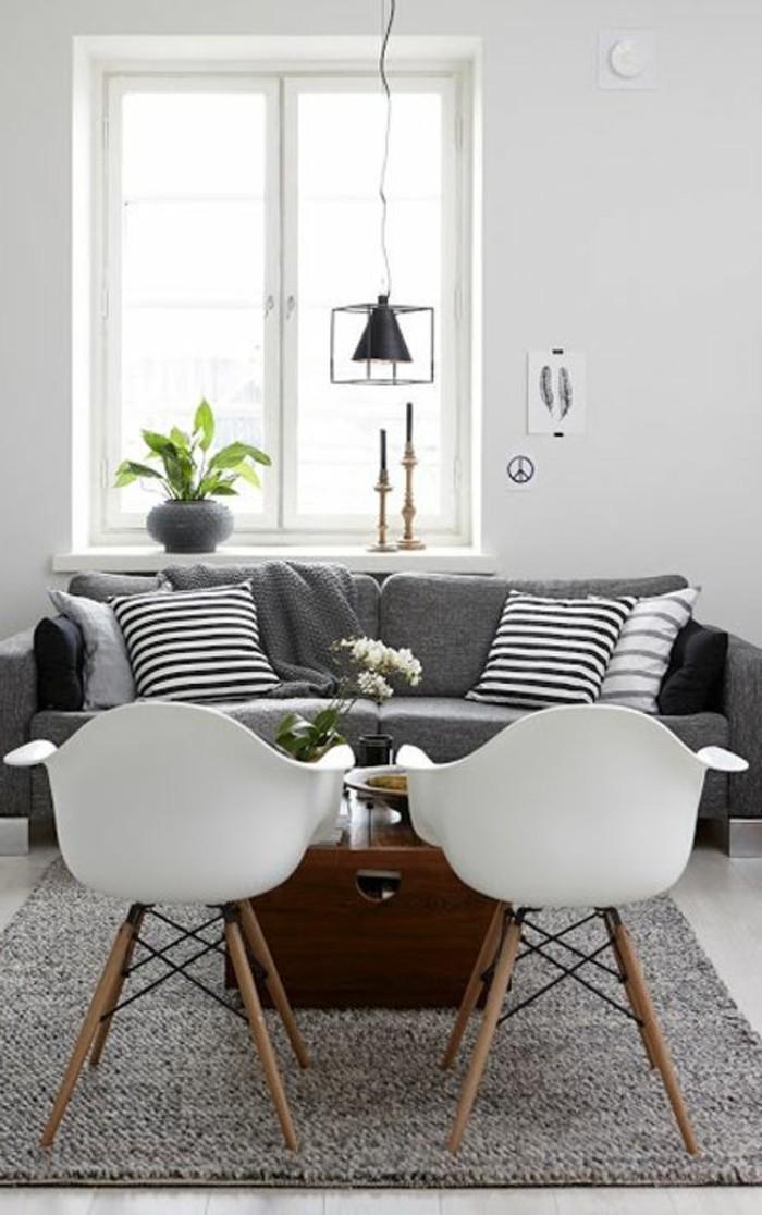un-joli-salon-scandinave-avec-tais-scandinave-gris-et-canapé-scandinave-gris
