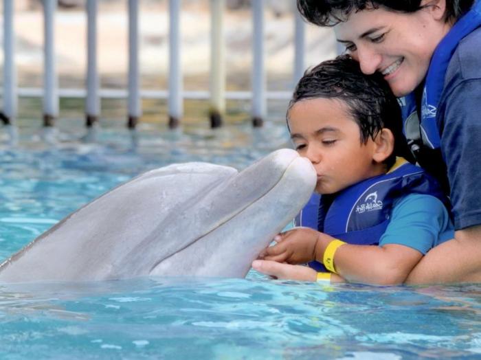 2-réaliser-son-rêve-nager-avec-les-dauphins-marineland-enfant-et-parent