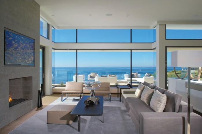 Baie-à-galandage-en-aluminium-idée-design-d-intérieur-à-la-mer-vue-du-salon-luxueux