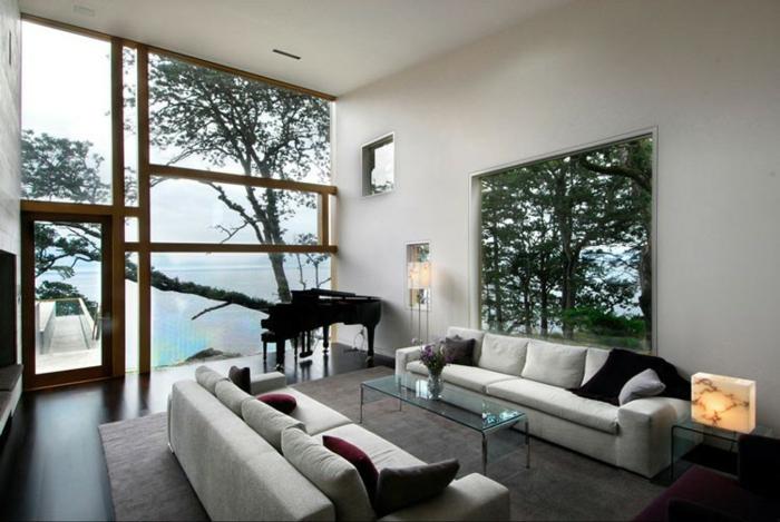 Baie-à-galandage-en-aluminium-idée-design-d-intérieur-vue-de-la-mer-piano-canapé