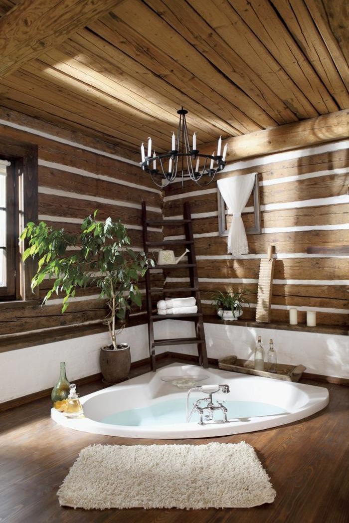 amenagement-petite-salle-de-bain-jacuzzi-dans-le-sol-avec-parquet-en-bois-foncé