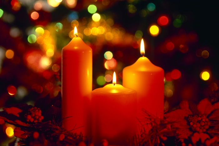 15 Jan 2010, Wirral, Merseyside, England --- Christmas candles lit, England --- Image by © Paul Thompson/Corbis