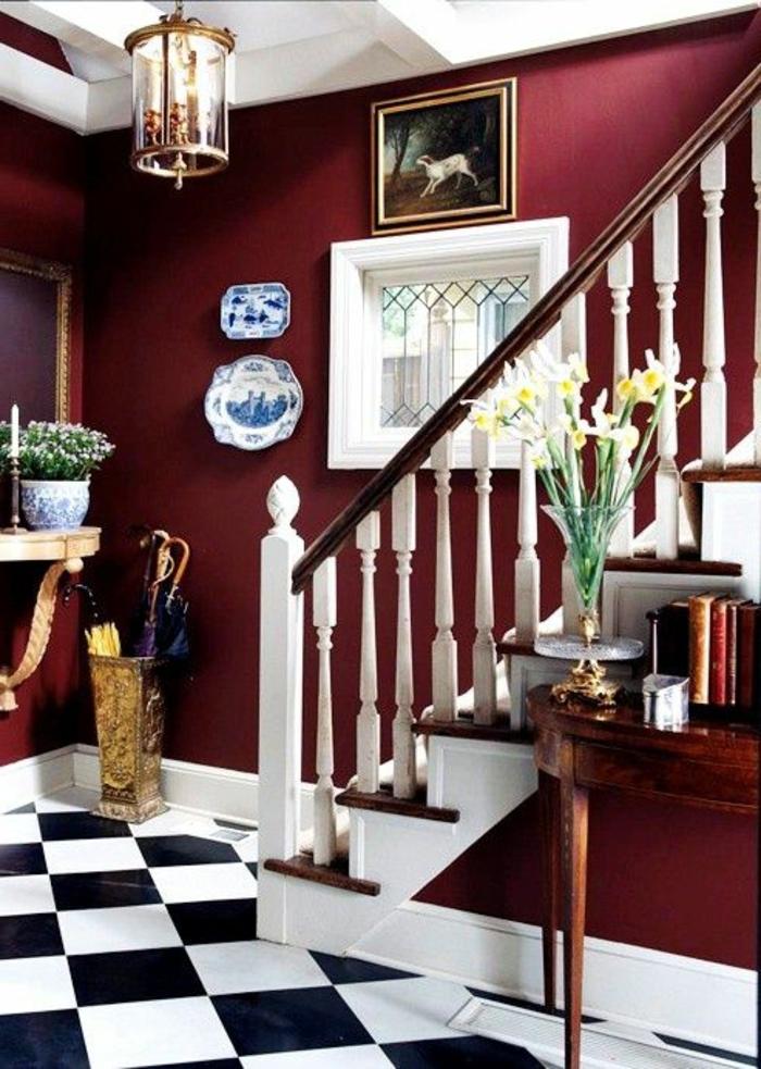 joli-couloir-avec-murs-couleur-hexa-et-sol-en-carrelage-blanc-noir-fleurs-sur-la-table-d-appoint