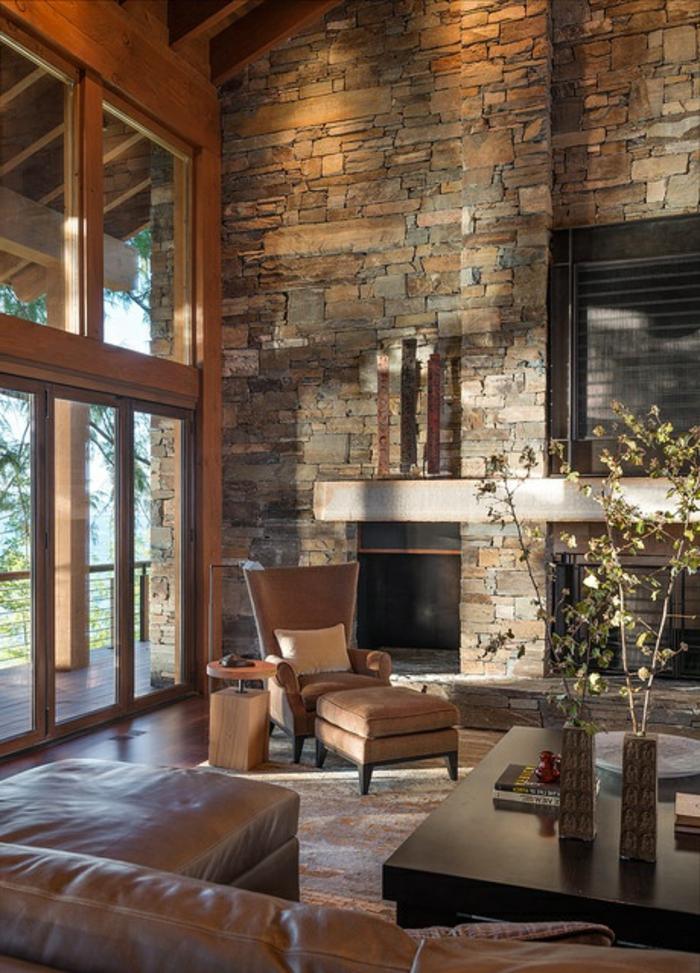 joli-salon-avec-mur-en-fausse-pierre-et-fauteuil-en-cuir-marron-foncé-salon-d-esprit-loft