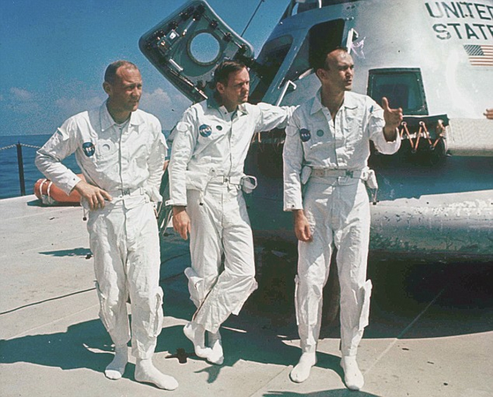 FILE - In this 1969 file photo, Apollo 11 astronauts stand next to their spacecraft in 1969, from left: Col. Edwin E. Aldrin, lunar module pilot; Neil Armstrong, flight commander; and Lt. Michael Collins, command module pilot. (AP Photo, file)