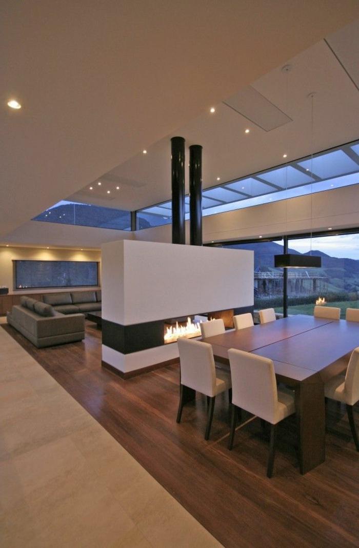 salle-a-manger-de-style-luxe-sol-en-parquet-foncé-tapis-beige-dans-la-salle-a-manger-contemporaine