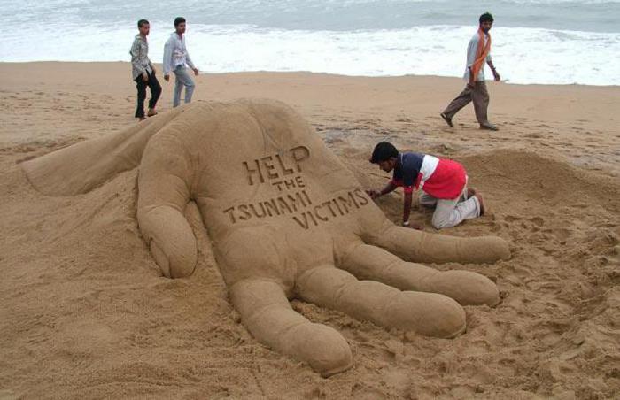 sculpture-de-sable-appel-original-sur-sable