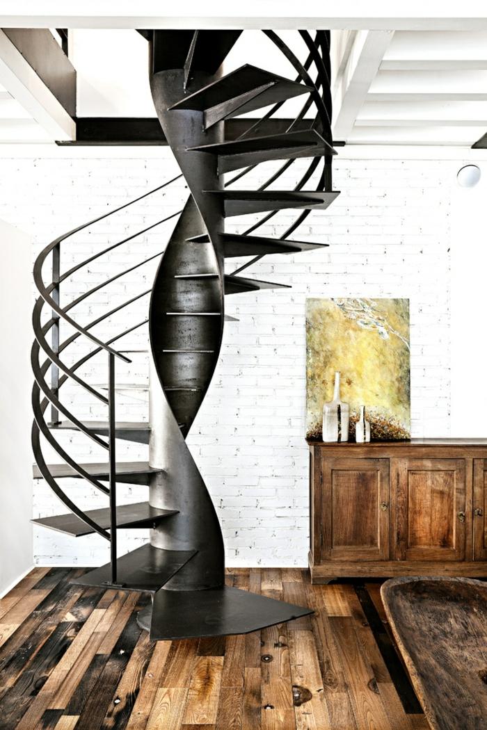 1-escalier-quart-tournant-en-fer-noir-et-mur-blanc-de-briques-blanches-meuble-en-bois-massif