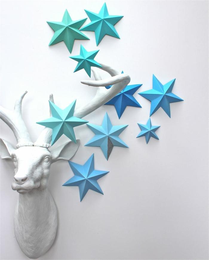 1-origami-facile-a-faire-en-forme-d-etoile-bleus-clairs-jolie-decoration-avec-etoiles