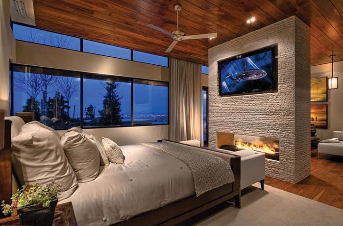 chambre-à-coucher-moderne-avec-cheminée-double-fâce