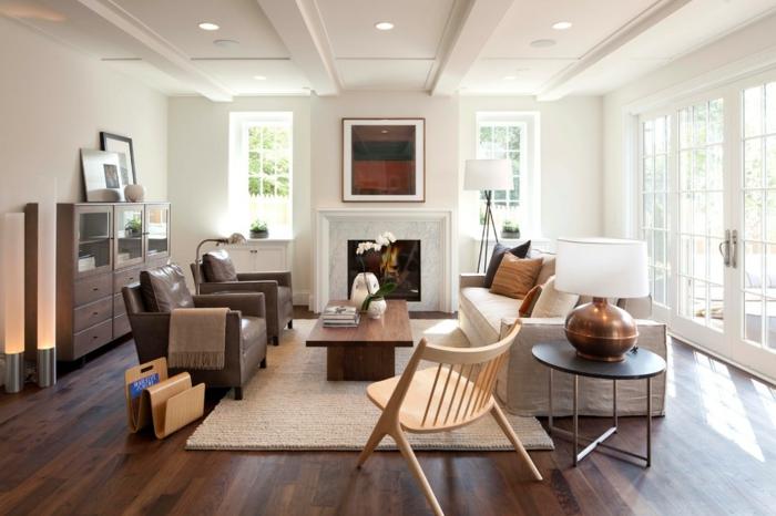 classique-salon-cheminée-fauteuil-cuir-brun-faire-l-aménagement-de-la-salle-de-séjour-lampedaire