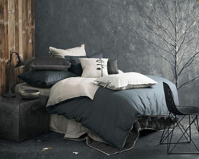 confort-sur-le-lit-la-taie-d-oreiller-tête-d-oreiller-cool-en-gris