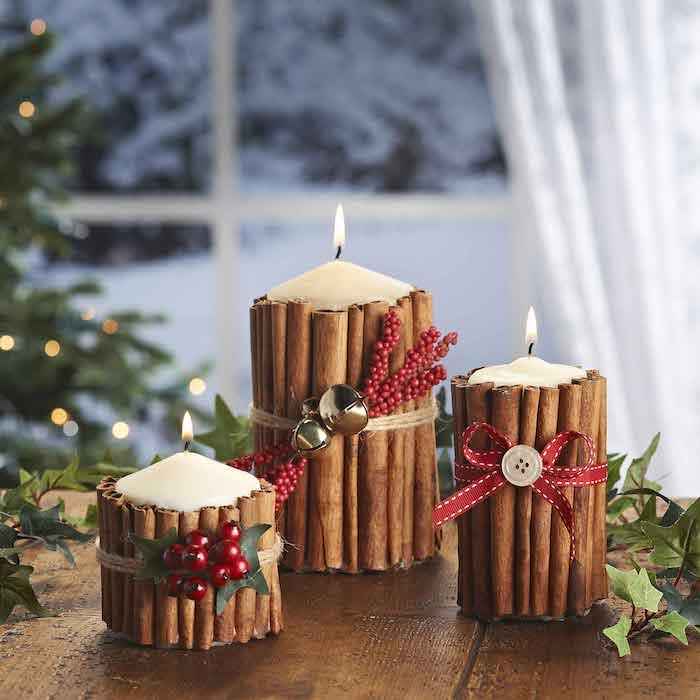 bougie décorée de batons de cannelle décorée de petites deco artificielles, deco table noel a fabriquer facilement