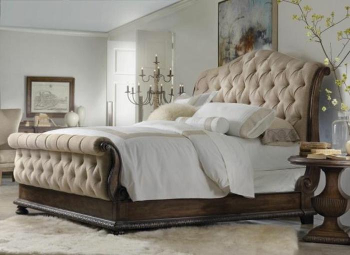 joli-tete-de-lit-captionnée-dans-la-chambre-a-coucher-avec-lit-captionne-en-bois-massif-et-tapis-blanc-lit-capitonné