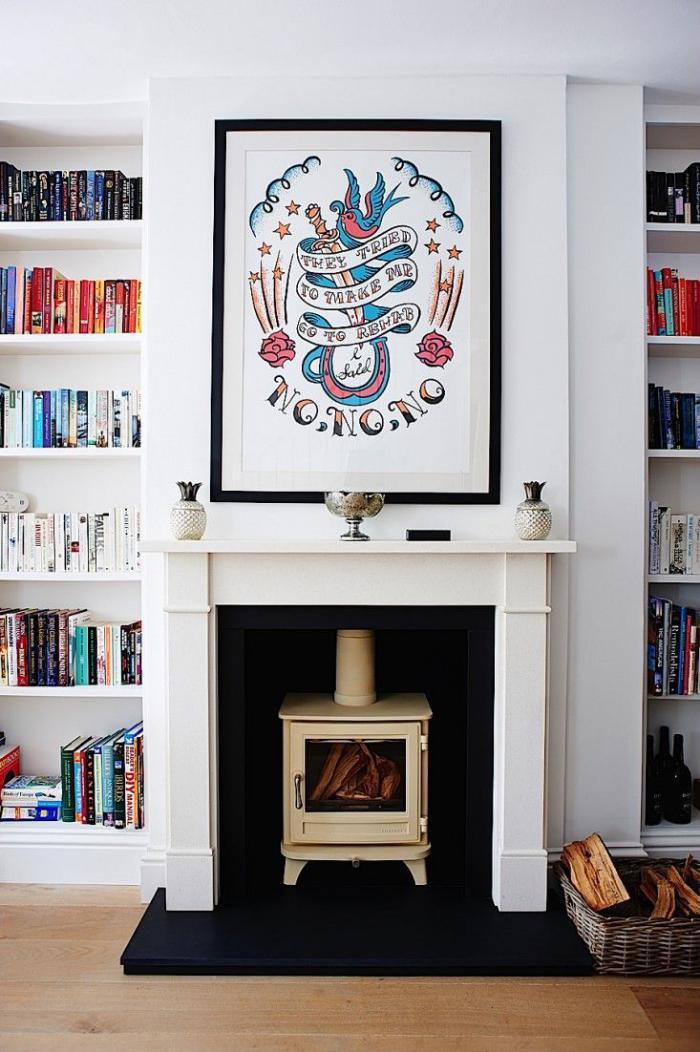 manteau-de-cheminée-blanc-et-bibliothèque-blanche