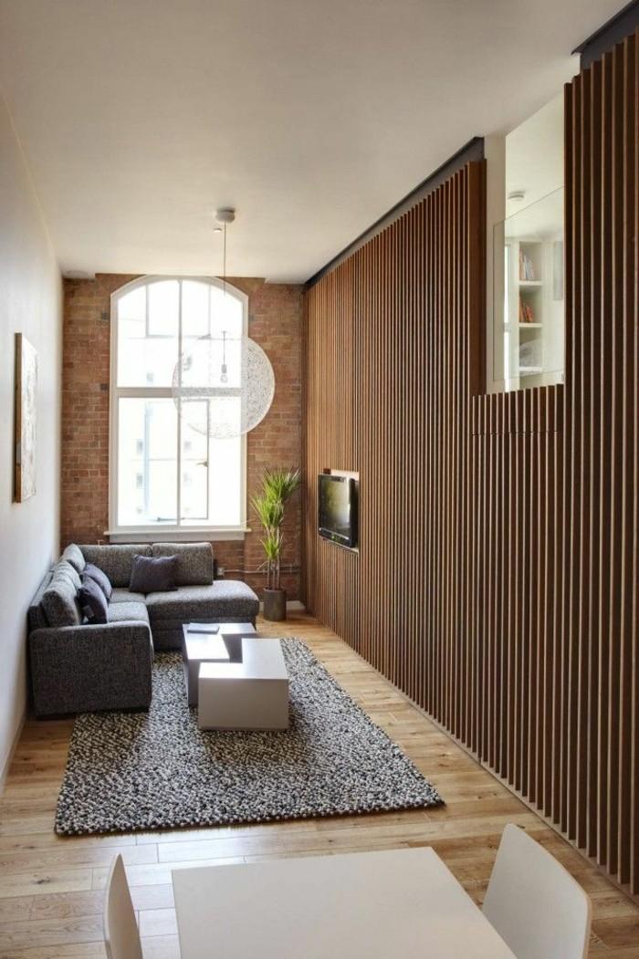 1-portes-placard-persiennes-pour-les-meubles-dans-le-salon-sol-en-parquet-clair-et-mur-de-briques