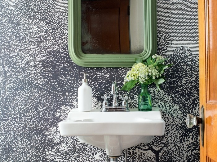 Small bathrooms can be a challenge to decorate, but they can also be a great place to be bold and daring with pattern, color and style. It's a perfect room for some graphic wallpaper that will make a big statement in this little space.