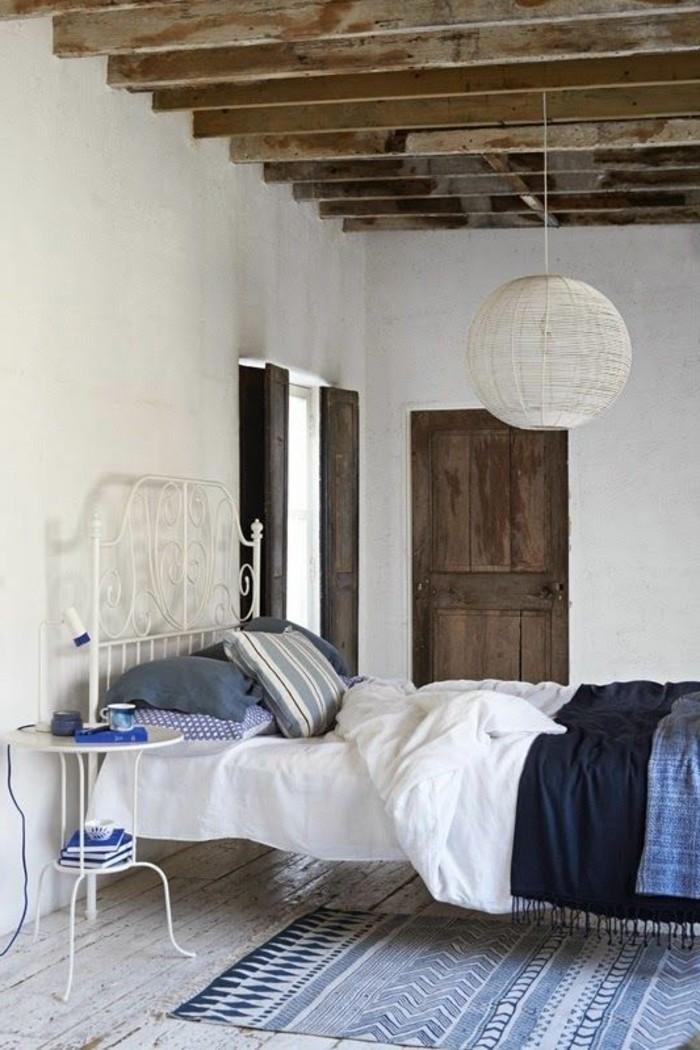 comment-creer-una-ambiance-scandinave-dans-la-salle-à-coucher-moderne-tapis-beige-bleu