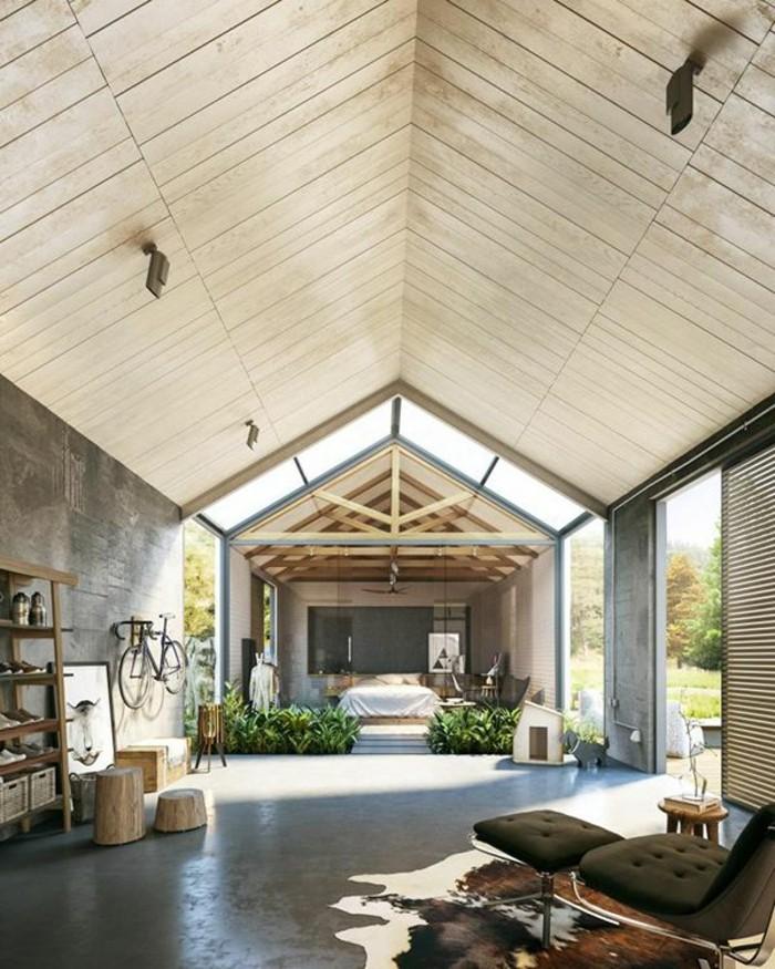 jolie-maison-sous-pente-avec-plafond-rectangulaire-tapis-en-peau-d-animal-sol-en-beton-cire
